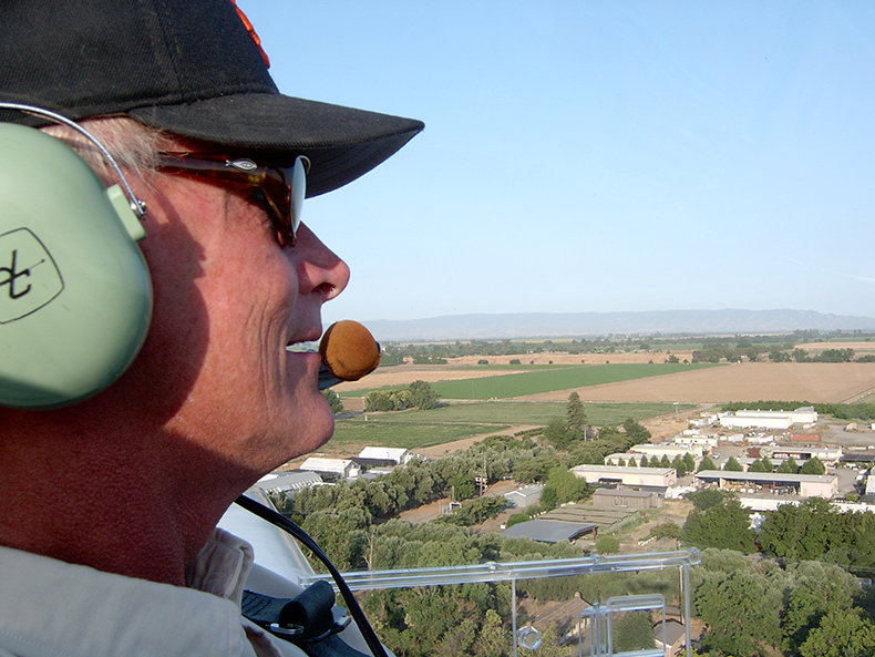 "Rand pilots his Grob motorglider named ""Elsa""."