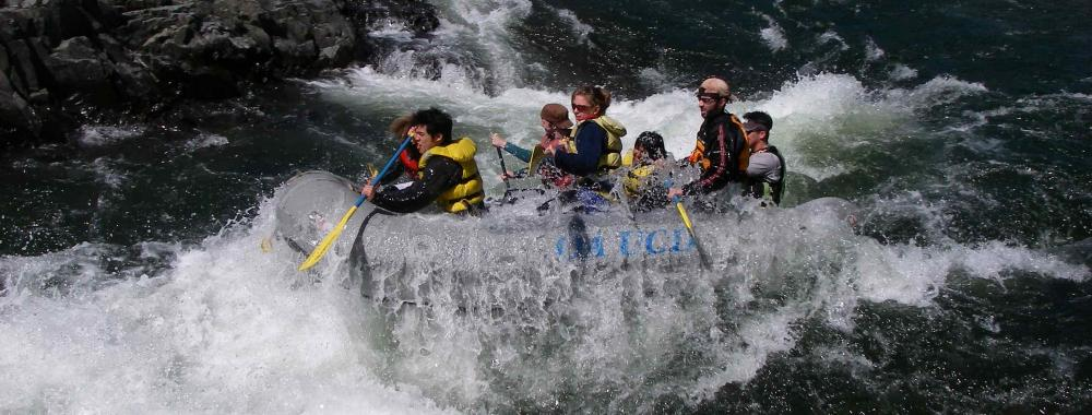 Students rafting down the rapids