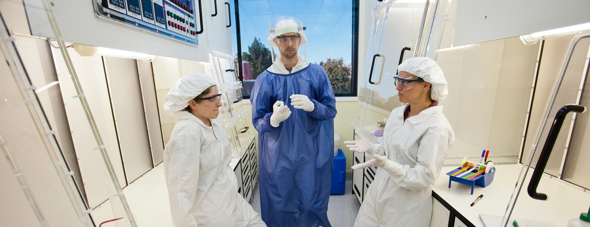 Researchers standing inside the clean lab.